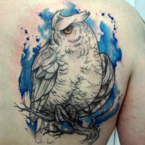 Выбор места и стиля для татуировки совы